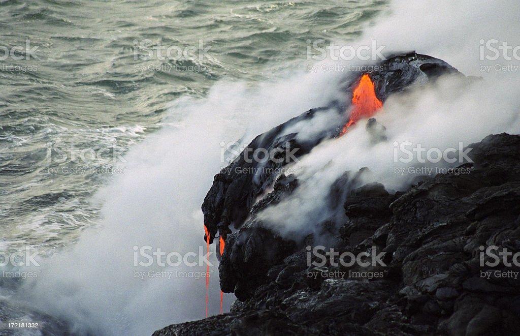 Lava Dripping into the Sea stock photo
