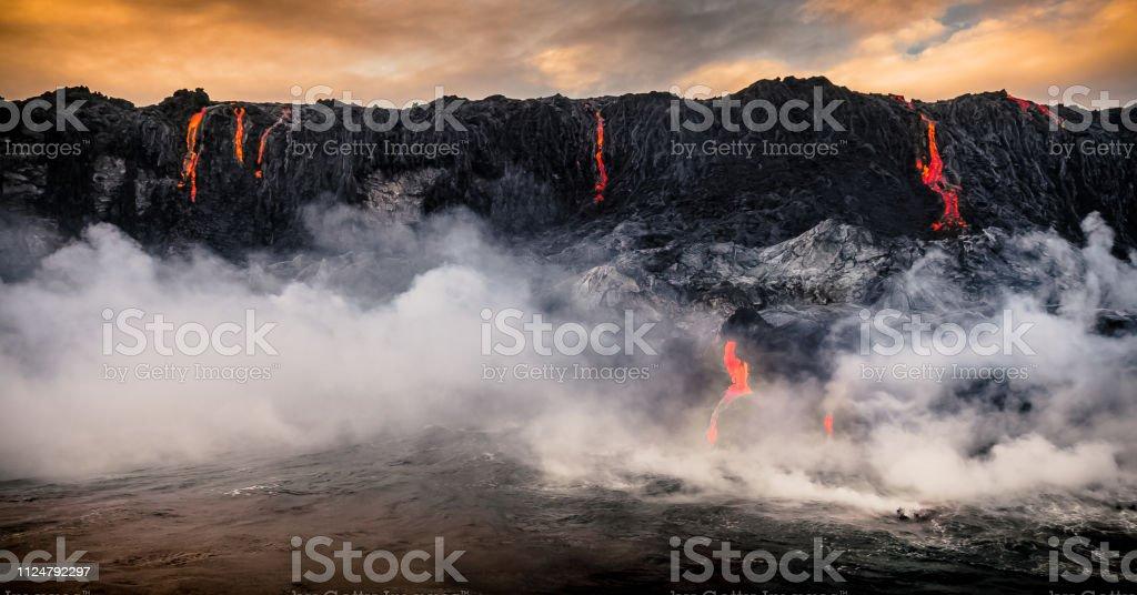 Lava Falls Lava flowing off the coast of the Big Island Hawaii and pouring into the Sea. Big Island - Hawaii Islands Stock Photo