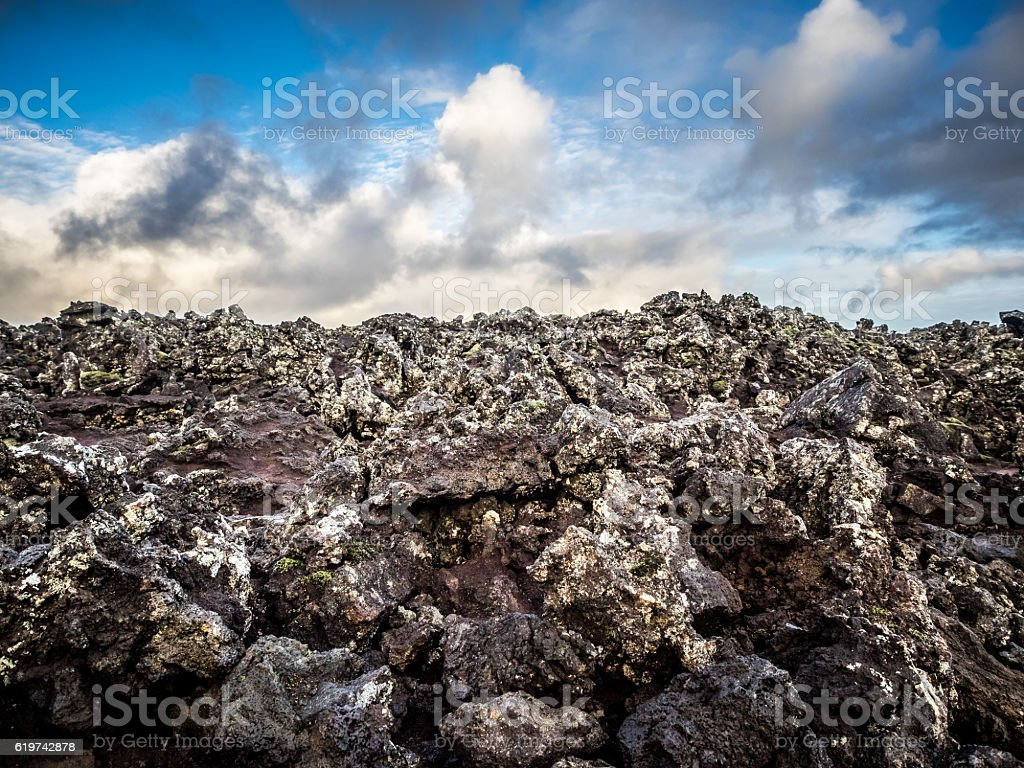 Lava Field in Iceland, Closeup View with Dramatic Clouds stock photo