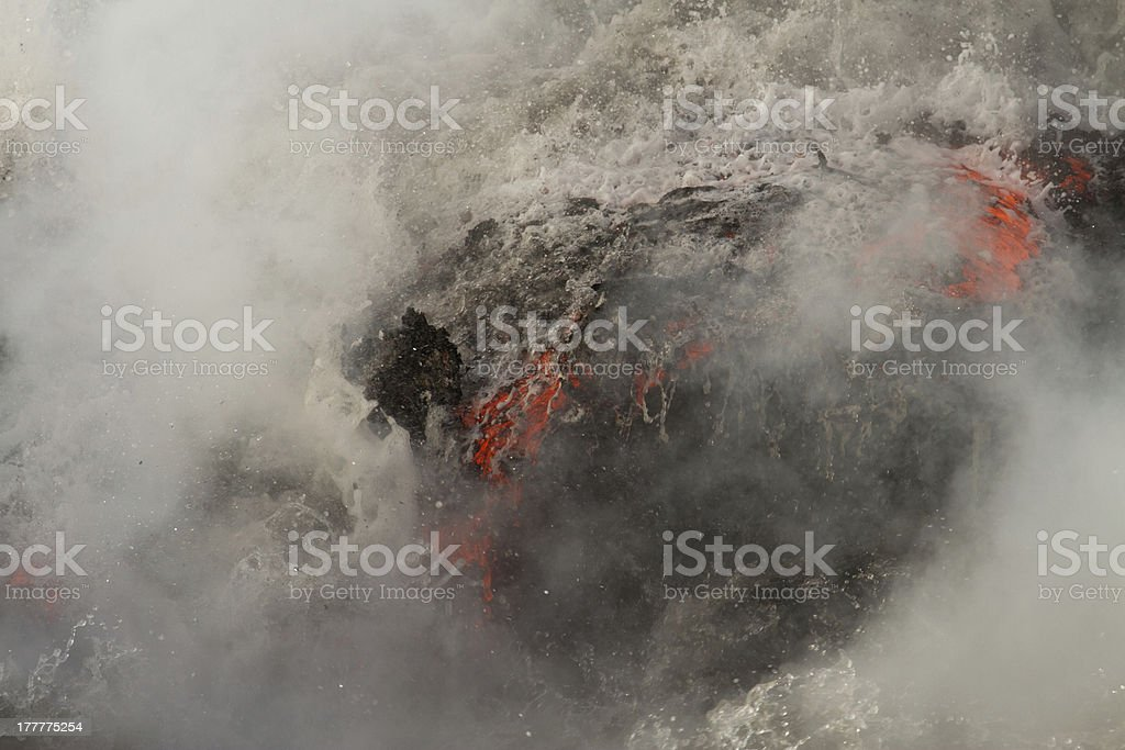 Lava flow enters the sea royalty-free stock photo
