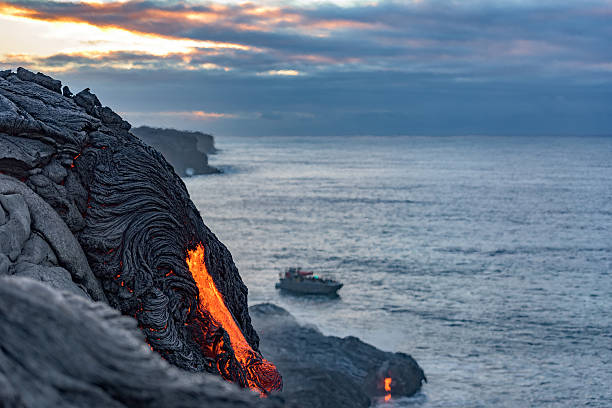 Lava from the Kilauea volcano floes into the Pacific ocean stock photo
