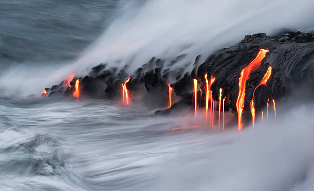 Lava Ocean Entry, Kilauea, Hawaii Lava entering the Pacific Ocean on Kilauea, Big Island, Hawaii. volcano stock pictures, royalty-free photos & images