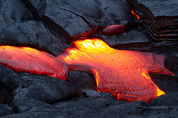 Lava A lava breakout on Kilauea, Hawaii. volcano stock pictures, royalty-free photos & images