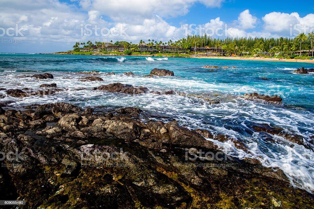 lava rock, white foam, napili bay, maui, hawaii stock photo