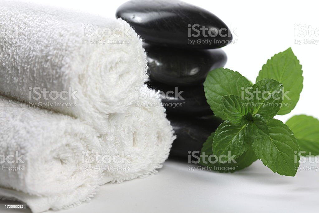 Lava Stones with Towels and Mint Leaves royalty-free stock photo