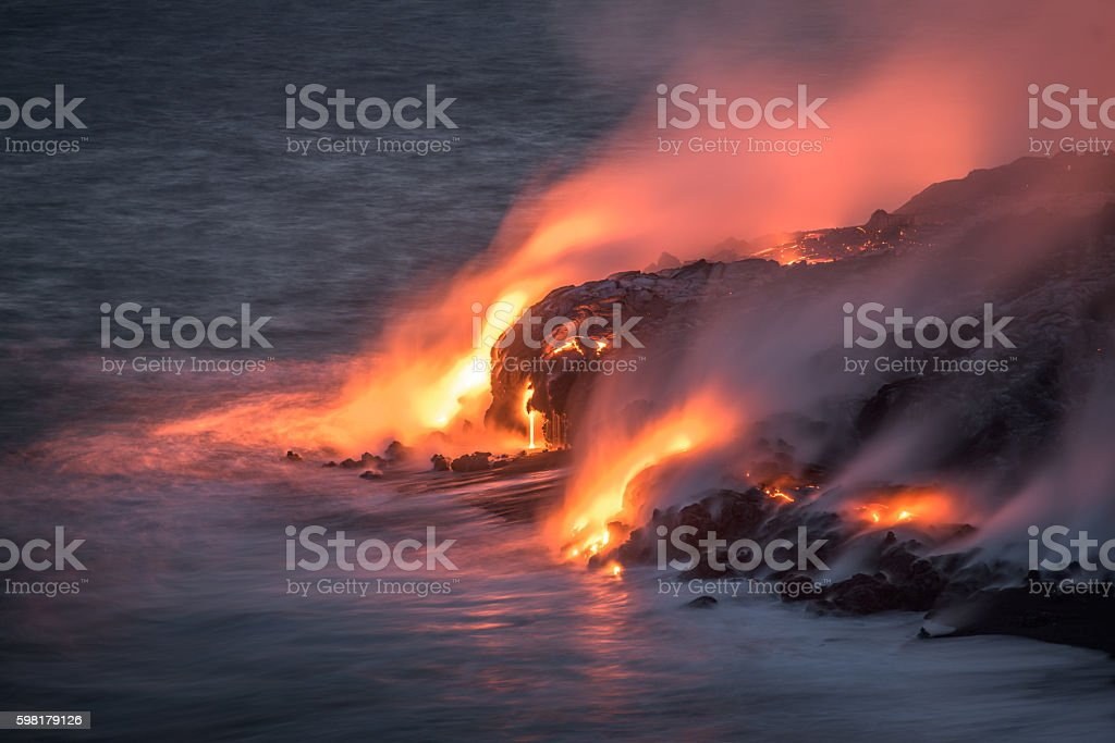 Lava stream of Kilauea volcano running into the Pacific Ocean stock photo