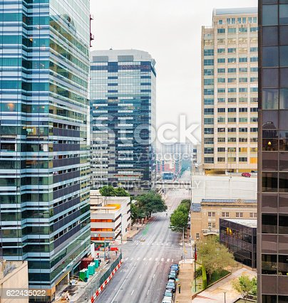Austin, USA - November 5, 2016: Lavaca street elevated view in Austin, Texas on an overcast morning. Construction workers are at work on a new building's sidewalk.