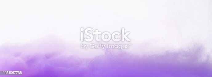 Colored smoke swirling underwater on white background, copy space. Lavander mist concept, panorama