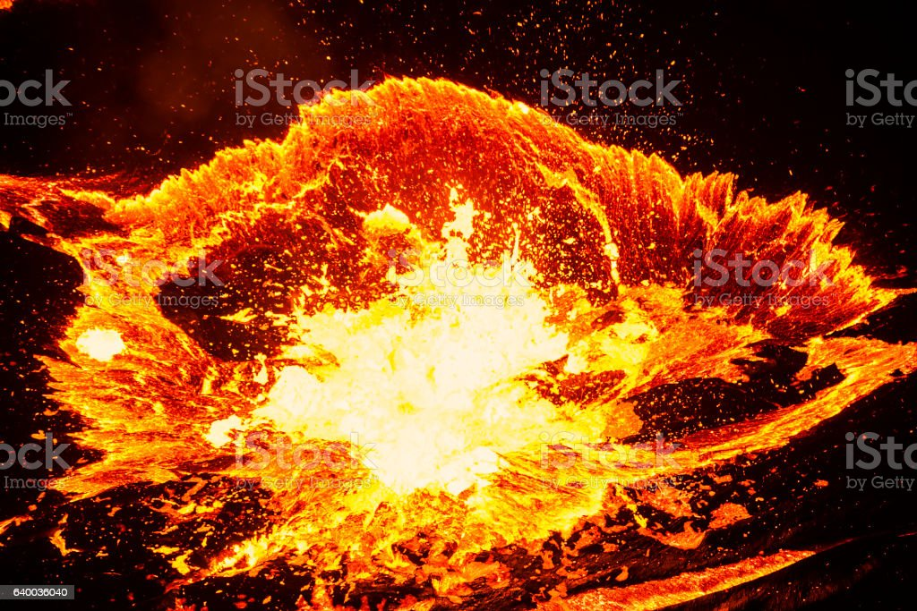 Lave explosion during eruption of volcano stock photo
