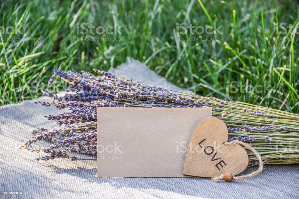 Lavender and romantic letter. empty sheet of paper and bouquet of...