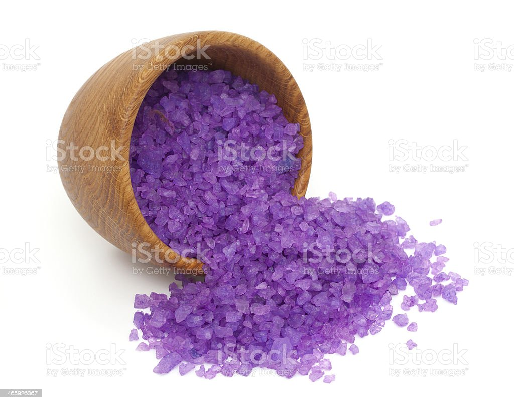 lavender bath salt in a wooden spoon and bowl stock photo