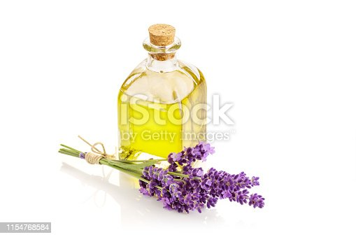 Lavender essential oil in glass bottle isolated on white background