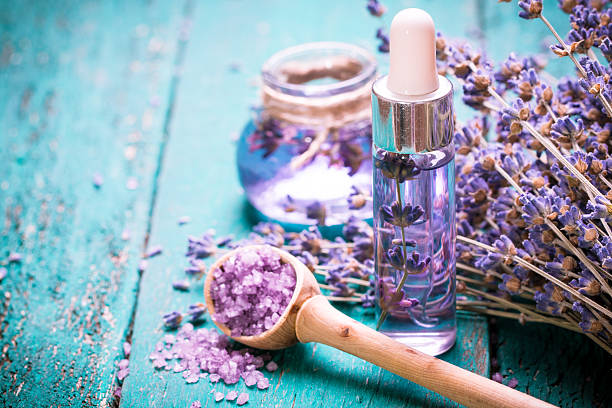 lavender flower,oil,salt, spa beauty concept. wood old background. - aromaterapi stok fotoğraflar ve resimler