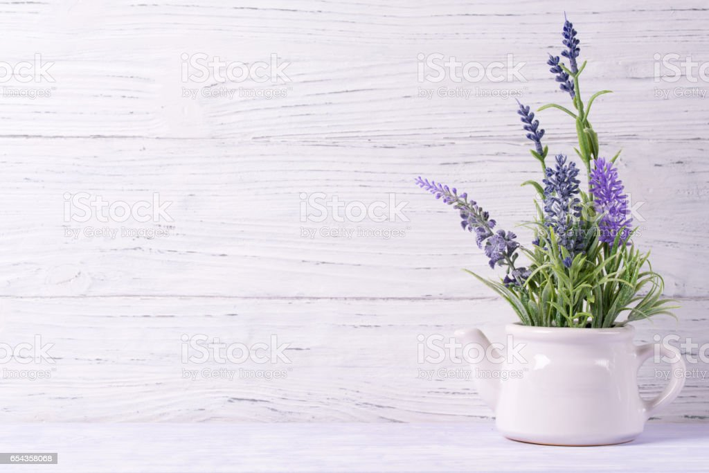 Lavender flowers in watering can, wooden background, copy space stock photo