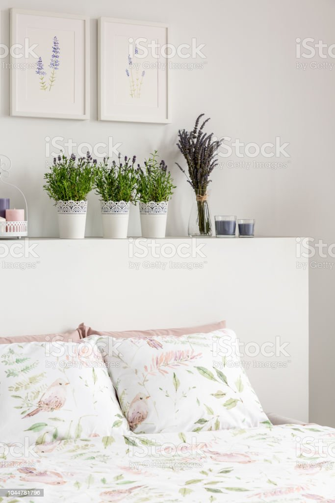 Lavender Flowers On Headboard Of Bed With Pillows In White ...