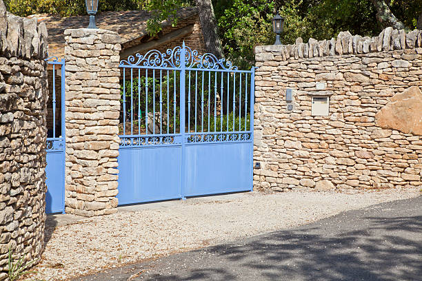 Lavender Gate in Stone Wall stock photo