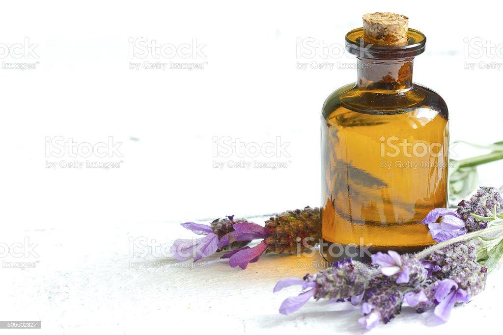 Lavender oil on white planks stock photo