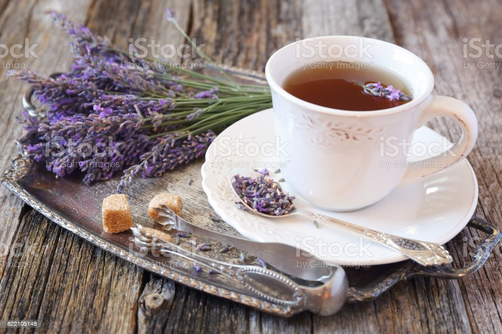 Lavender tea and fresh lavender on vintage tray stock photo