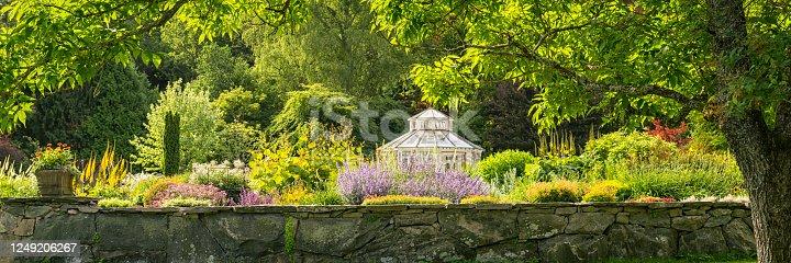 Lush foliage in lavish garden. Gothenburg botanical garden, Sweden. Free entrance public park. The white Gazebo is now gone and replaced by another Gazebo.