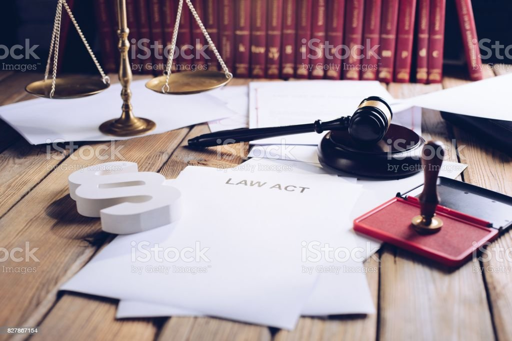 Law act on old wooden desk in library stock photo