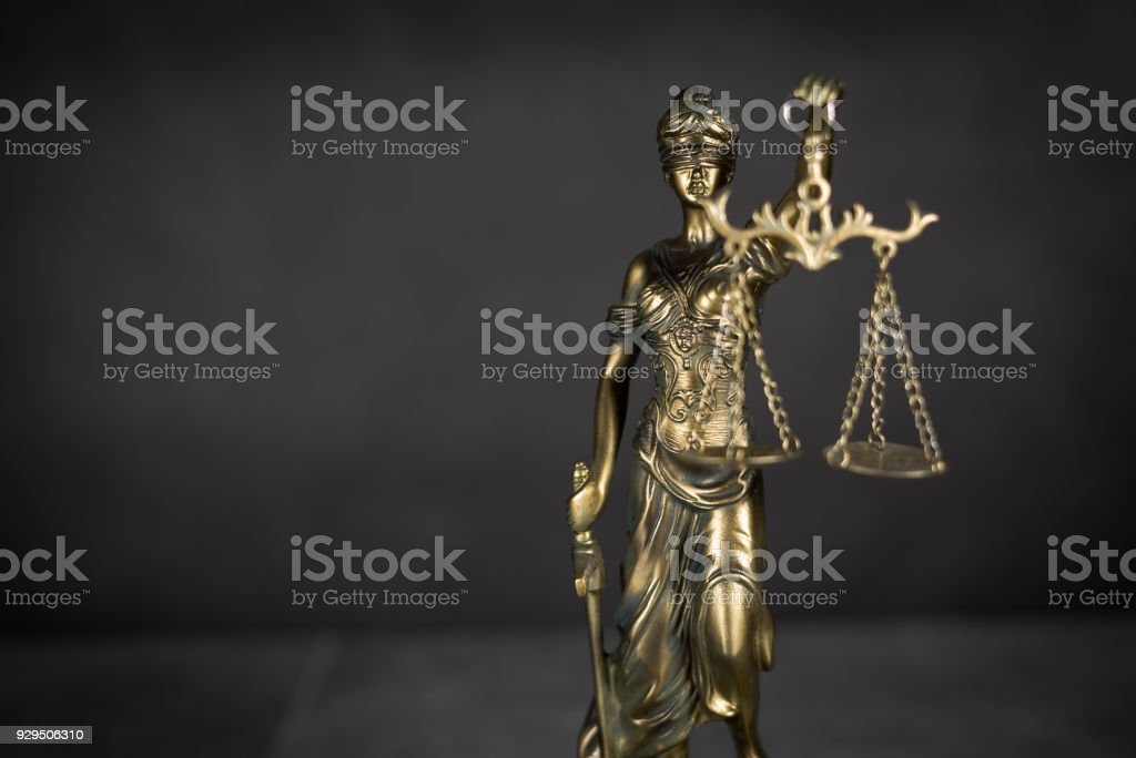 Law and Justice concept. Gray stone background, reflections on the floor, place for typography. Courtroom theme. stock photo
