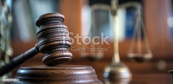 istock Law and Justice concept. Mallet of the judge, books, scales of justice. 698689964