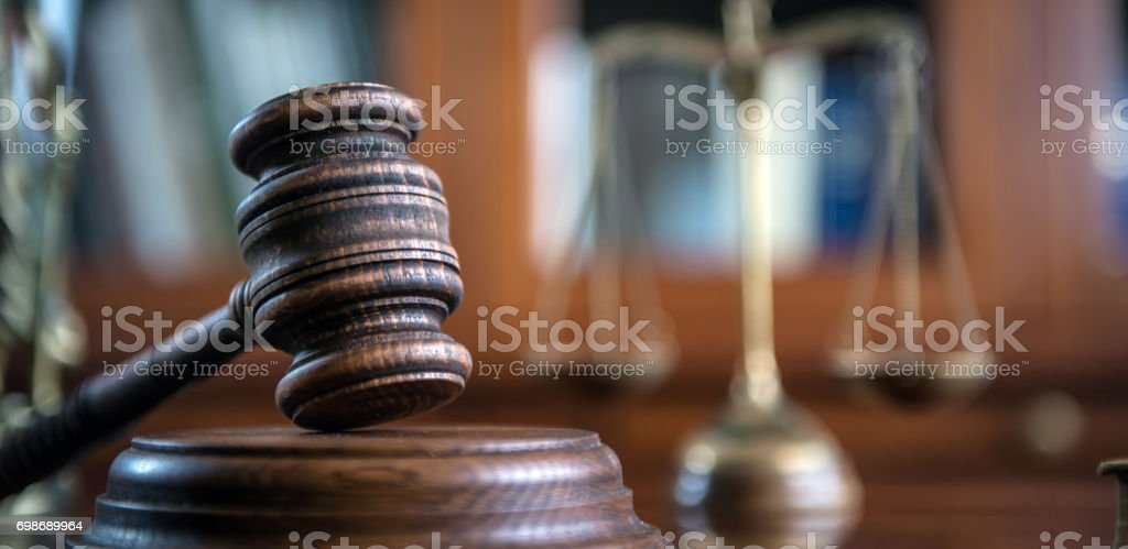 Law and Justice concept. Mallet of the judge, books, scales of justice. stock photo