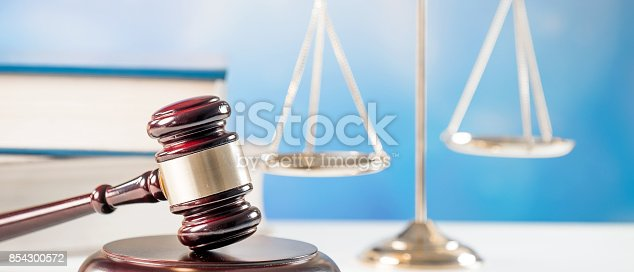 istock Law and Justice concept. Mallet of the judge, books, scales of justice.  Courtroom theme. 854300572