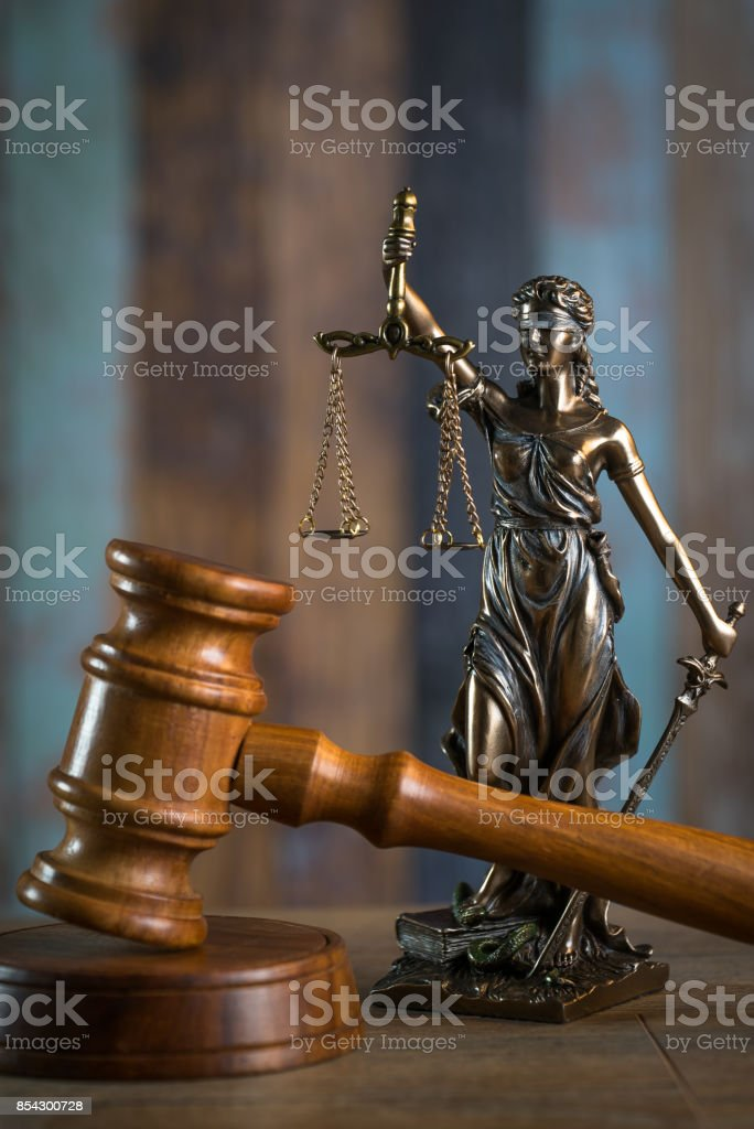Law and Justice concept. Mallet of the judge, books, scales of justice.  Courtroom theme. stock photo
