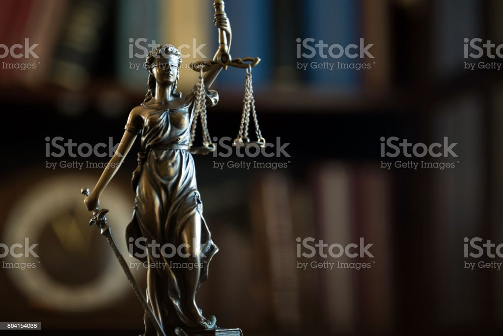 Law and Justice concept. Mallet of the judge, books, scales of justice. Gray stone background, reflections on the floor, place for typography. Courtroom theme. royalty-free stock photo
