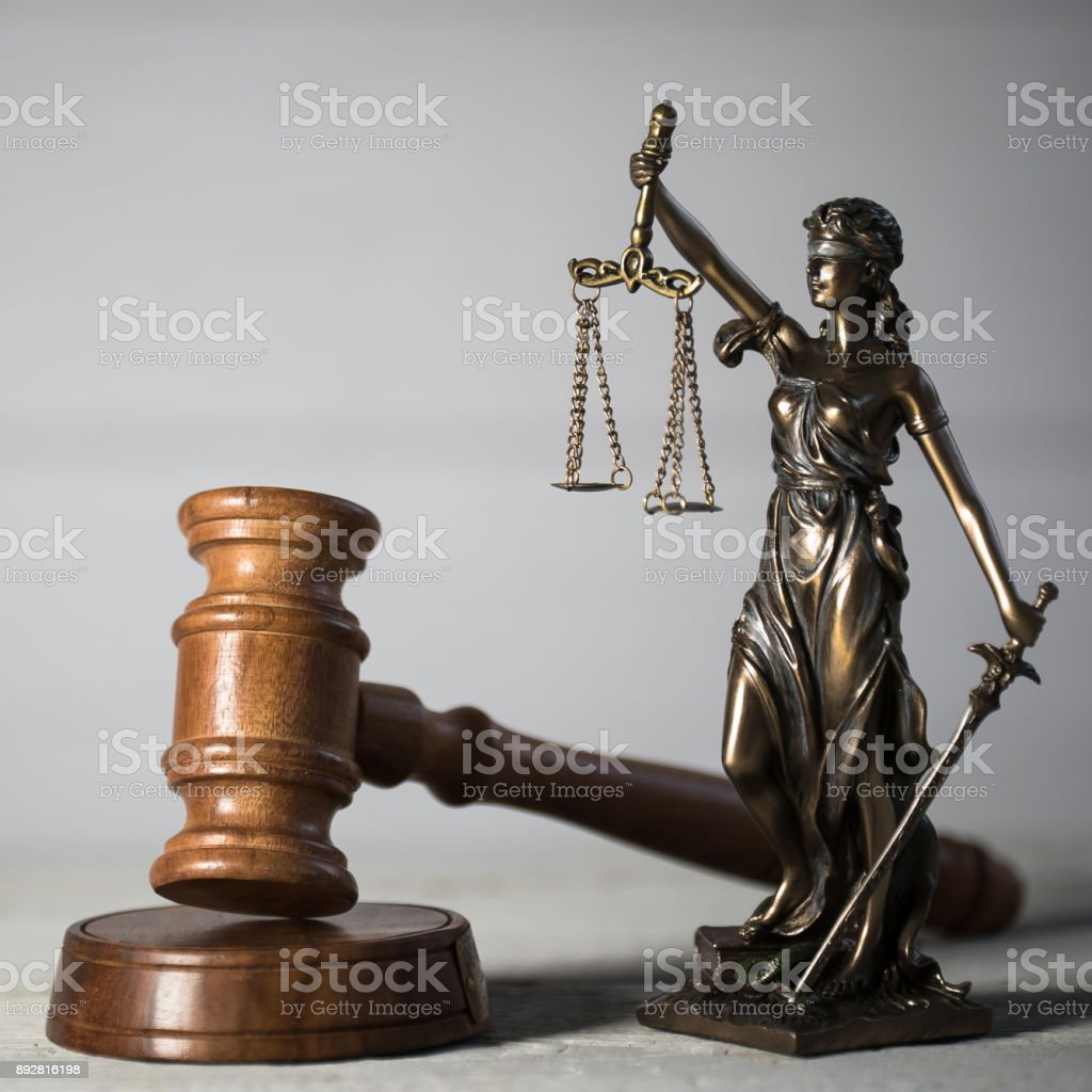 Law and Justice concept. Mallet of the judge,  Gray background, place for typography. Courtroom theme. stock photo