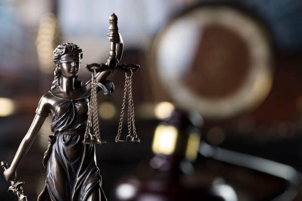 Law and justice concept. Themis statue and judge's gavel in the old court library. lawsuit stock pictures, royalty-free photos & images