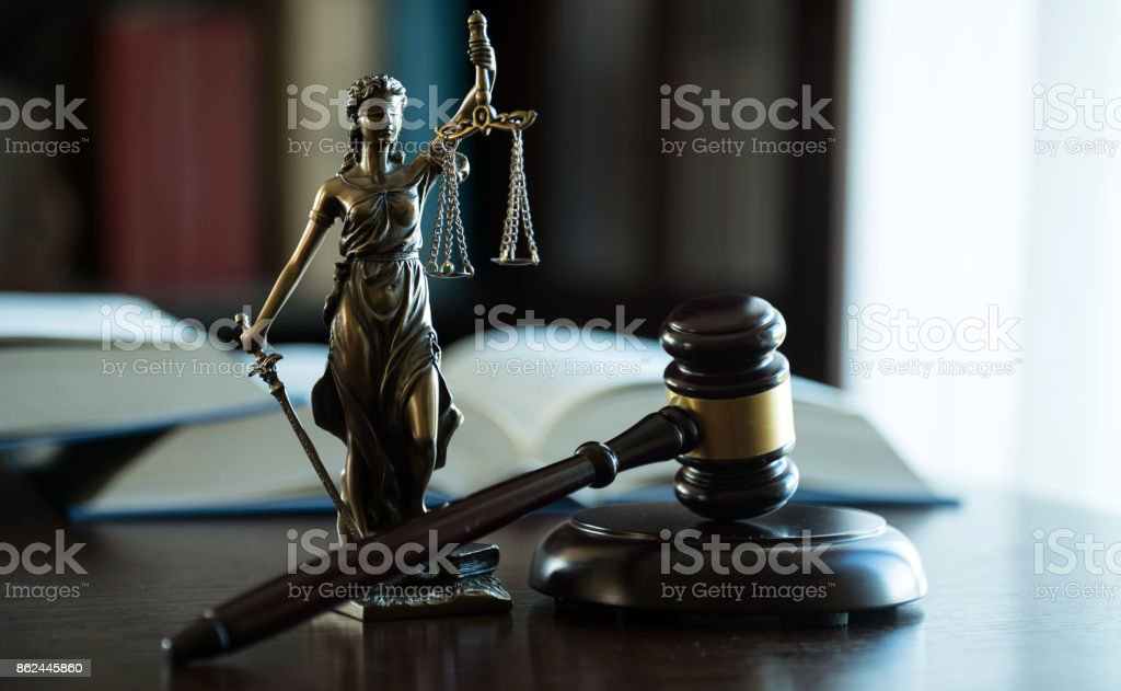 Law and Justice symbols on dark background stock photo
