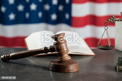 istock Law and justice symbols on USA flag background. 844516128