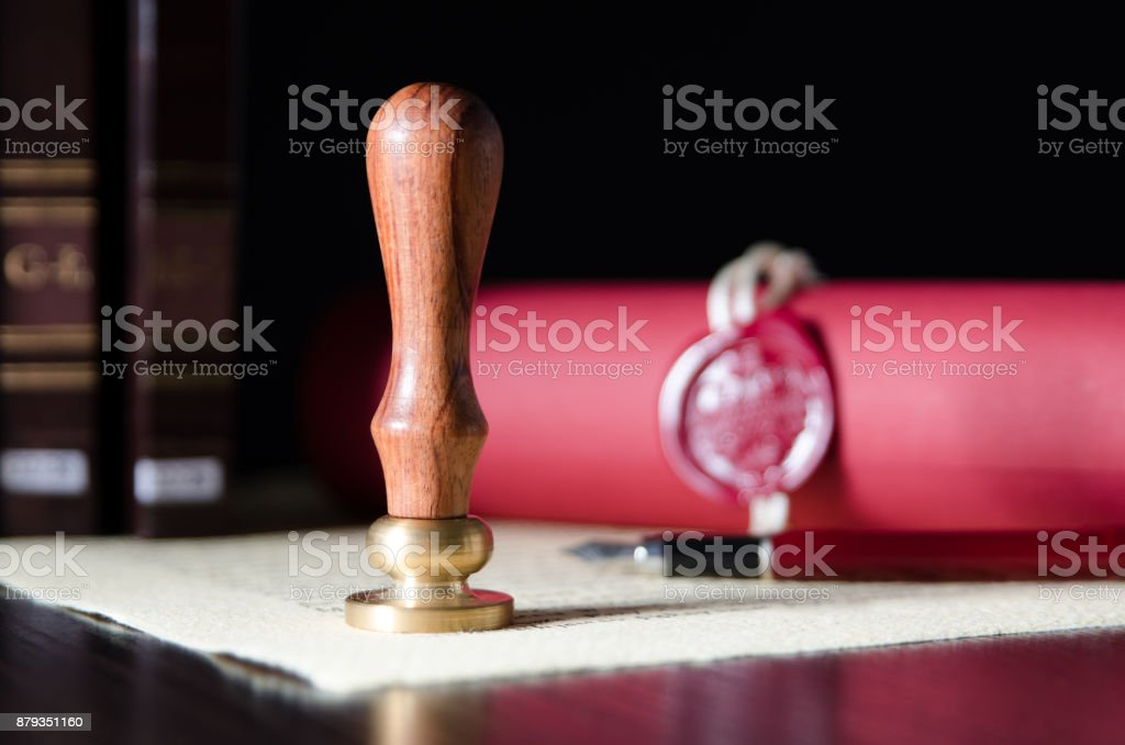 Law, attorney, notary public stamp and pen on desk stock photo