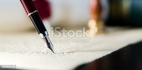 istock Law background theme. Fountain pen and handmade paper 850906436