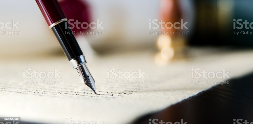 Law background theme. Fountain pen and handmade paper stock photo