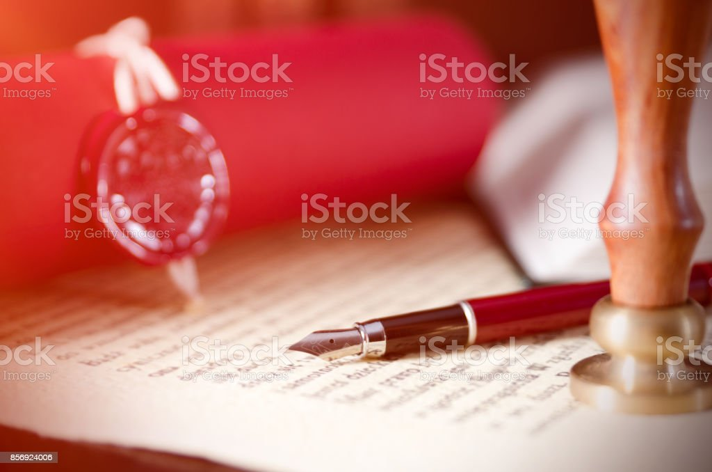 Law background theme. Fountain pen and handmade paper. stock photo
