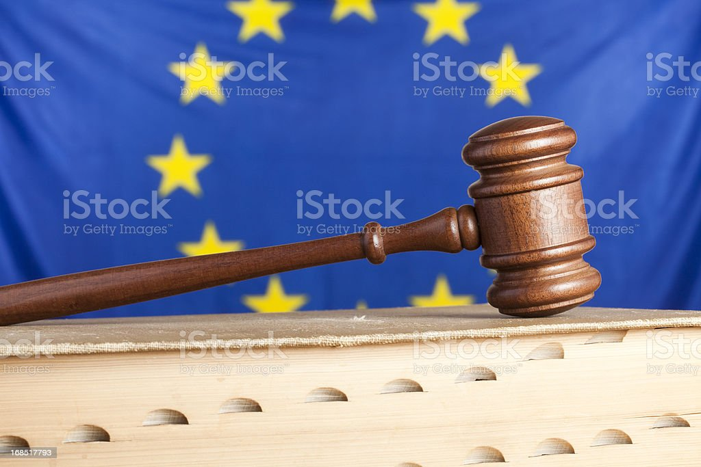 Law book and EU flag royalty-free stock photo