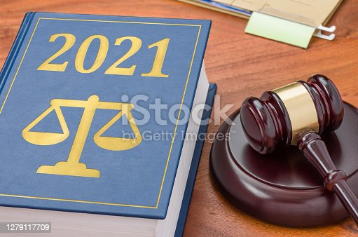 Law book with a gavel - 2021
