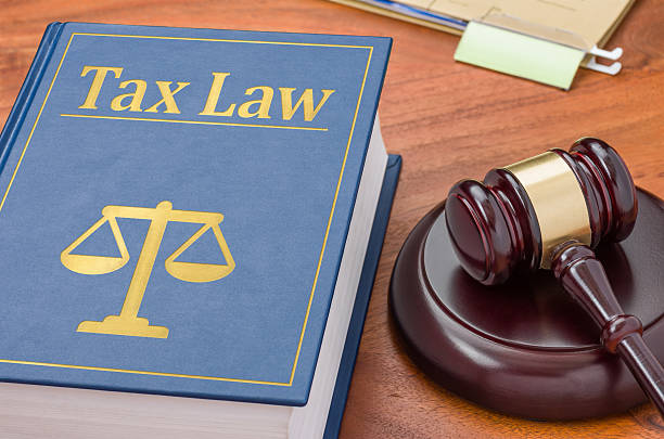 Law book with a gavel - Tax law stock photo