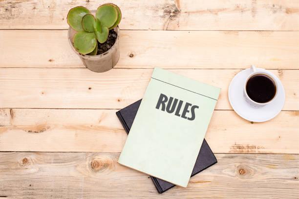 law book with rules word on wooden table - supreme court zdjęcia i obrazy z banku zdjęć