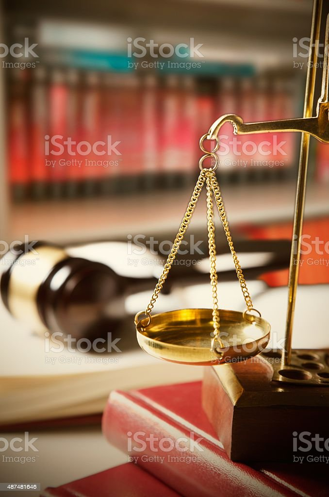 Law composition with scale and gavel on books stock photo