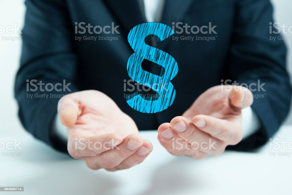 Law concept above the hands of a man in background - Royalty-free Adult Stock Photo