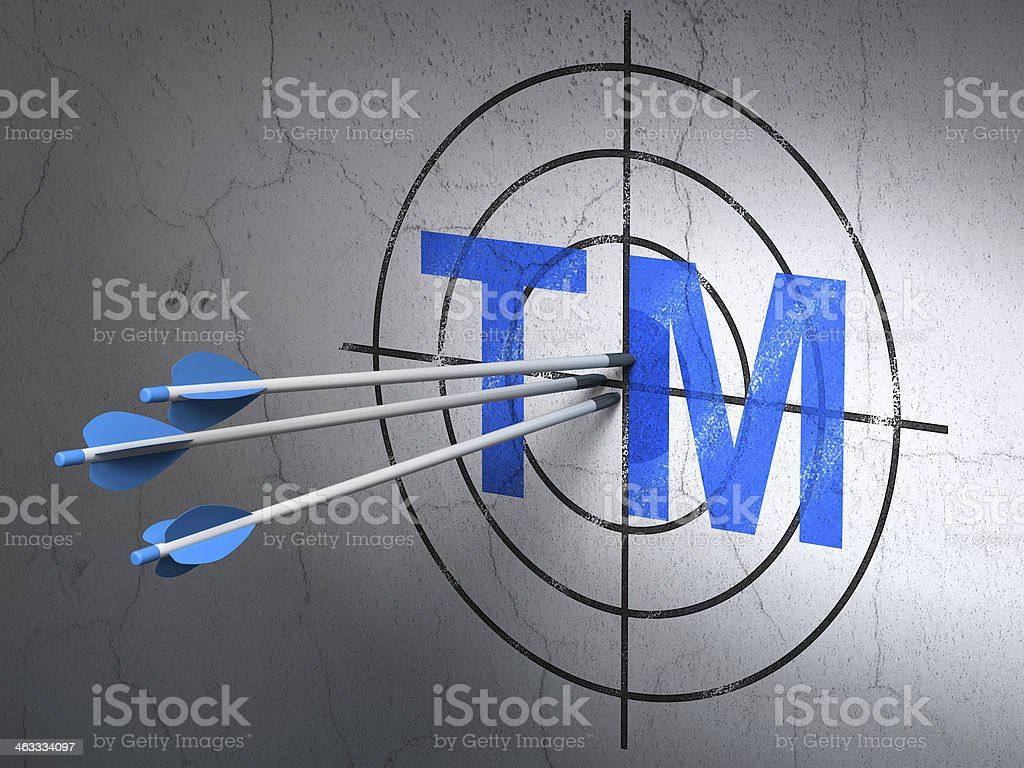 Law concept: arrows in Trademark target on wall background stock photo
