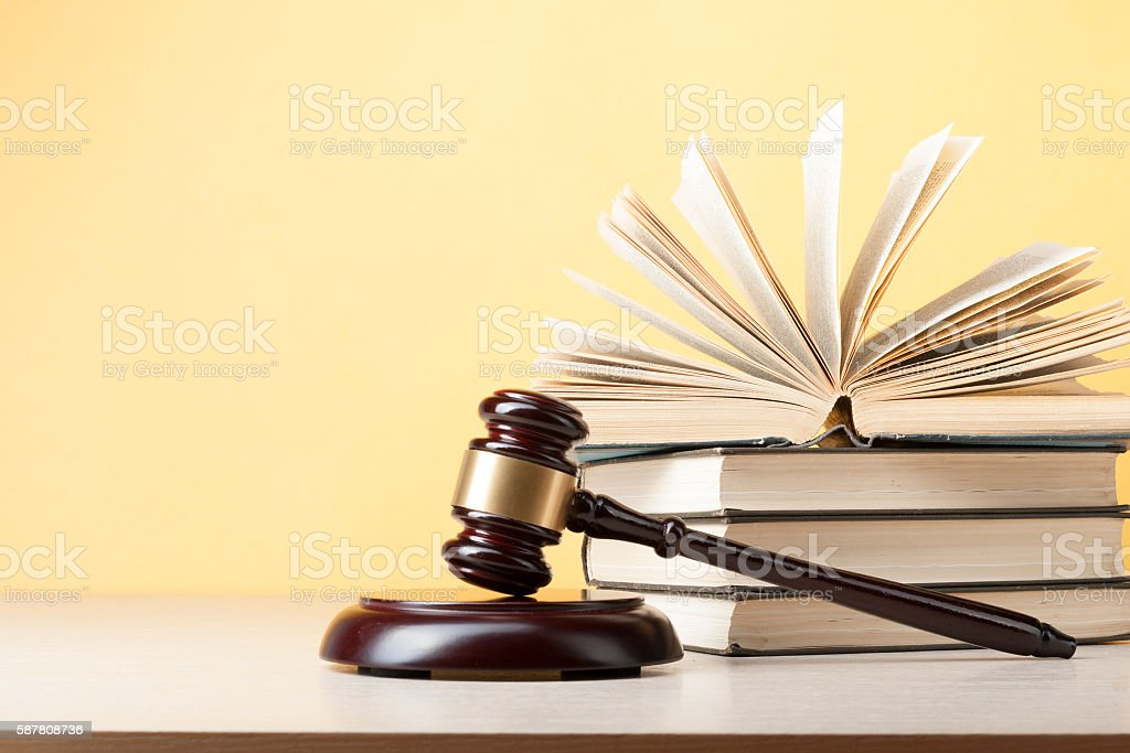 Law concept - Book with wooden judges gavel on table stock photo