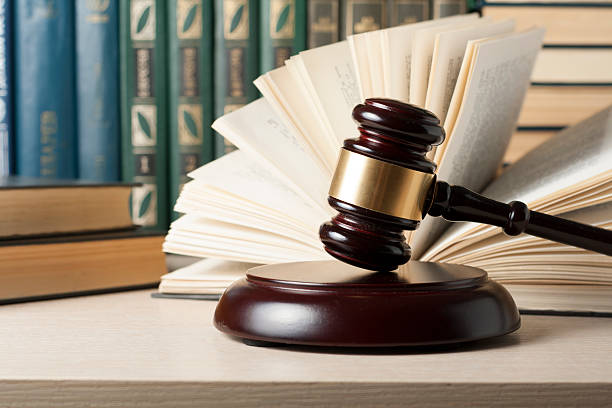 Law concept - Book with wooden judges gavel on table Law concept - Book with wooden judges gavel on table in a courtroom or enforcement office jurist stock pictures, royalty-free photos & images