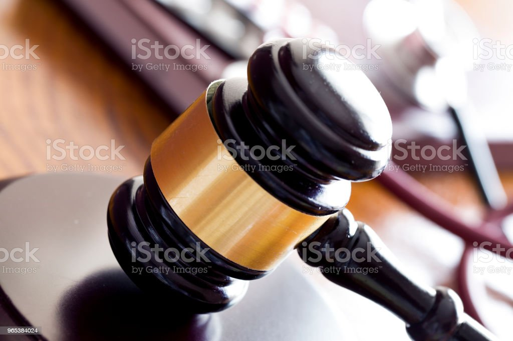 Law concept. Gavel and stethoscope on wooden table royalty-free stock photo