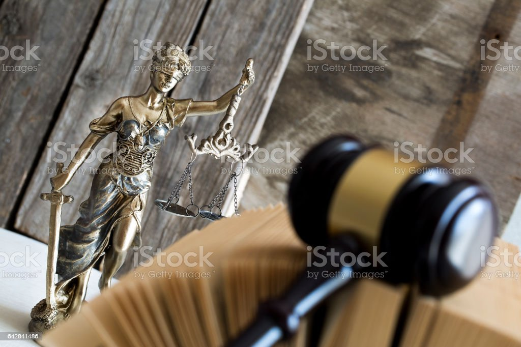 Law concept. Judge gavel, statue and book - Royalty-free Adult Stock Photo