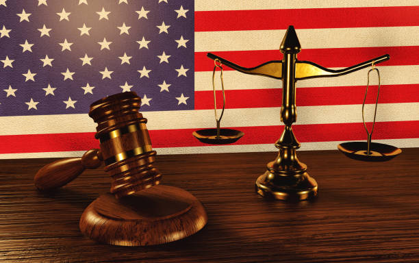 law concept -judges gavel and law scales on the background of the us flag - supreme court стоковые фото и изображения